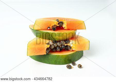 Fresh Ripe Papaya Slices On White Background