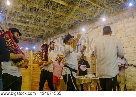 Safed, Israel - September 28, 2021: Prayers Carrying The Torah Scrolls (hakafot, Circuits), Part Of