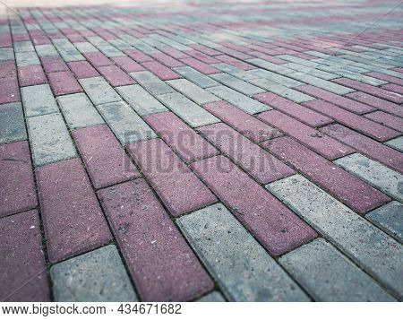 Texture Of Paving Slabs: A Footpath Lined With Bricks Of Paving Slabs. Background Of Stone Paving Sl