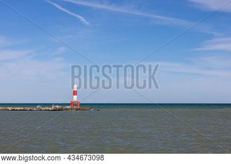 A Marker Light Tower On A Breakwater Along Lake Michigan.