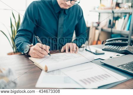 A Man Hand Planning Daily Appointment And Note At Office Desk. Planner Plan Schedule Calendar And Re