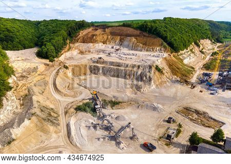 Open Pit Mining Of Construction Sand Stone Materials With Excavators And Dump Trucks At Conveyor Bel