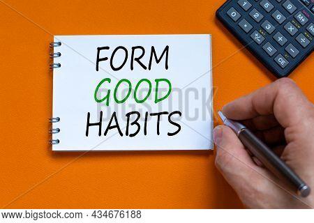 Form Good Habits Symbol. Businessman Writing Words 'form Good Habits' On White Note. Black Calculato
