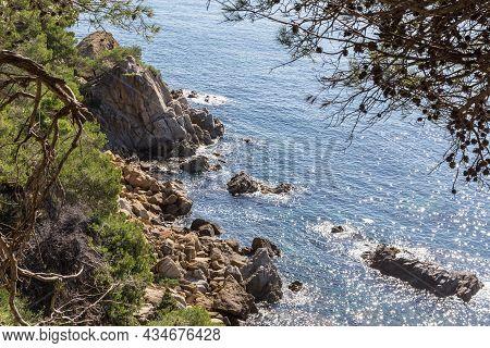 Rocky Coast Of The Costa Brava On A Sunny Summer Day. Costa Brava, Catalonia, Spain