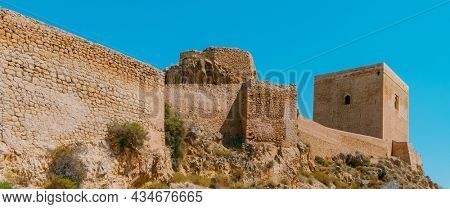 a panoramic view of the Castle of Lorca, in Lorca, in the Region of Murcia, Spain, highlighting the Torre Alfonsina tower on the right