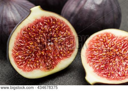 Two Halves Of Fig. Ripe Fruit Pulp. Close Up.