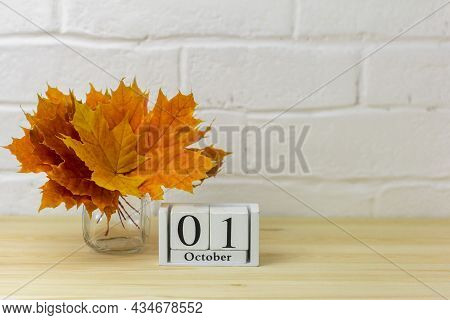 October 1 On The Calendar And A Bouquet Of Bright Autumn Leaves On The Table.one Of The Days Of The