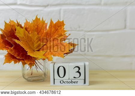 October 3 On The Calendar And A Bouquet Of Bright Autumn Leaves On The Table.one Of The Days Of The
