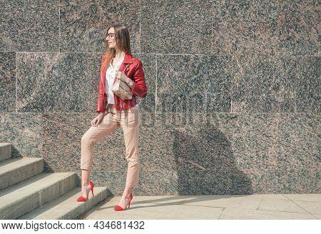 Beautiful Young Fashion Stylish Woman With Red Jacket