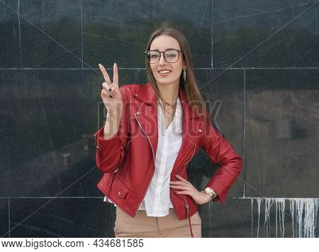 Beautiful Young Fashion Stylish Woman Showing Victory Gesture