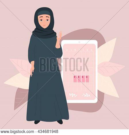 Girl Looks At Online Womens Calendar. Muslim Woman In Hijab. Stands Near Calendar Of Womens Health A