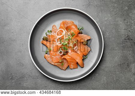 Salmon Carpaccio With Capers, Onion And Microgreens On Grey Table, Top View