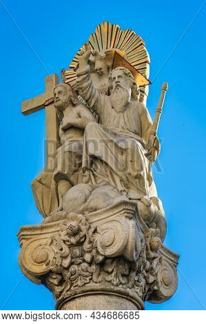 Detail Of Column With Statue Of Abraham And Isaac In Front Of Roman Catholic Church Saint Charles Bo