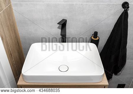 A Modern Washbasin In The Toilet In A Wall Mounted Cupboard With A Matte Black Faucet, A Wall Lined