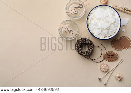 Flat Lay Composition With Homemade Candles Ingredients On Beige Background, Space For Text