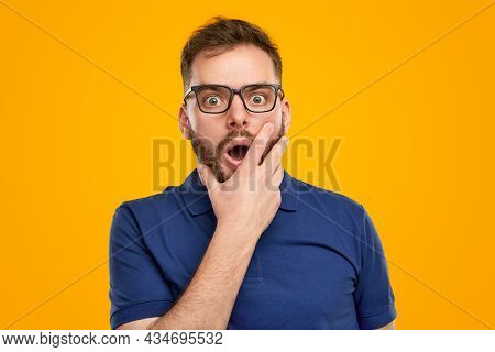 Astonished Young Bearded Guy In Casual Outfit And Glasses Making Omg Reaction And Looking Speechless