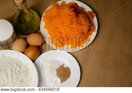 Concept Homemade Fall Baking With Pumpkin And Food Ingredients. Cooking Pumpkin Pie. Grated Pumpkin,