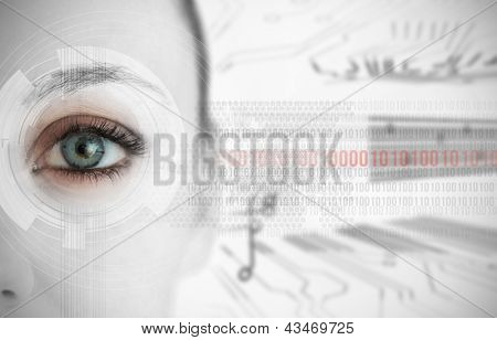Close up of woman eye with futuristic interface showing binary codes and circuit board background