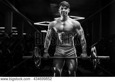 Athletic Man Exercising Pumping Up Biceps Muscles