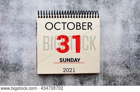 Woman Fingers With Pen Writing Reminder Reformation Day In Calendar. October 31