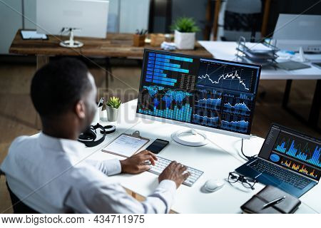 African Business Analyst Working Late Using Kpi Dashboard