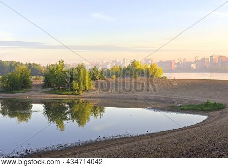 The Bank Of The Ob River In The Morning Fog. The Capital Of Siberia In The Distance In The Morning H