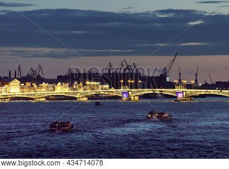 Blagoveshchensk Bridge At Night. Tourist Boats On The Neva River, Bridge Lighting, Silhouettes Of Po
