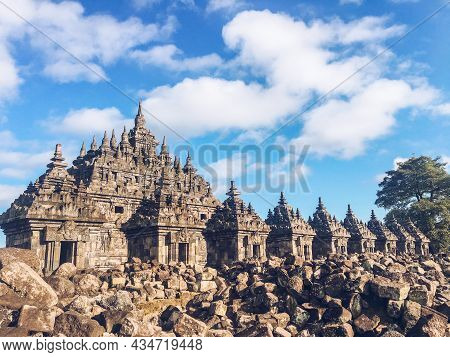 Many Small Temple In Plaosan Complex Temple With Blue Sky And Sunny Sun Background. One Of The Javan