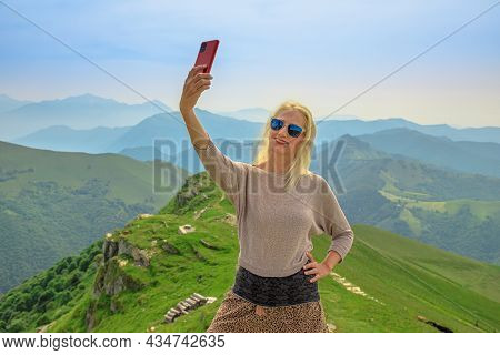 Tourist Woman Taking Selfie Pictures On Monte Generoso Skyline Or Calvagione Swiss Mount Of Ticino C
