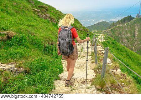Tourist Woman Backpacker Trekking In Monte Generoso Or Calvagione Swiss Mount. Skyline Of Lugano Lak