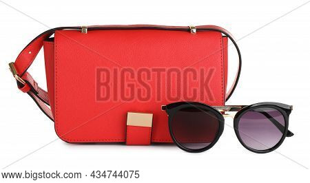Red Women's Leather Flap Bag And Sunglasses On White Background