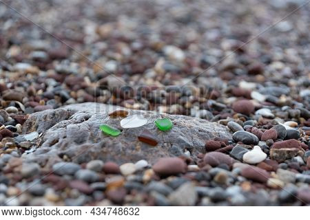 Sandy Beach By The Sea Arising From Broken Glass Bottles Which Was Repeatedly Hit By The Waves Until