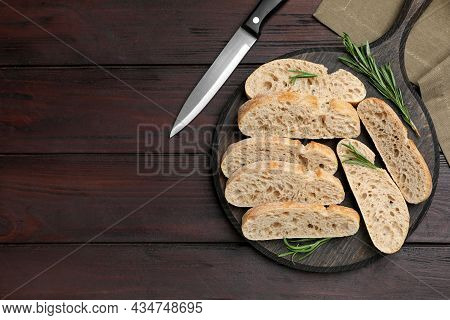 Delicious Ciabatta With Rosemary On Wooden Table, Flat Lay. Space For Text