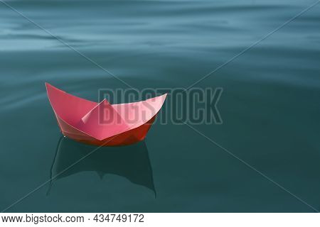 Pink Paper Boat Floating On Water Surface, Space For Text