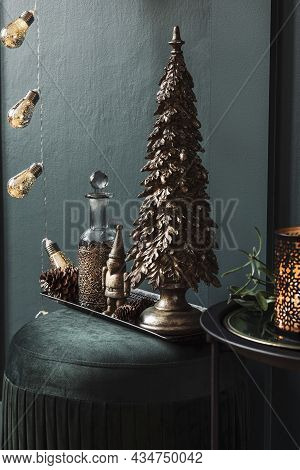 Christmas Composition On The Green Velvet Pouf In Living Room. Beautiful Decoration. Christmas Trees