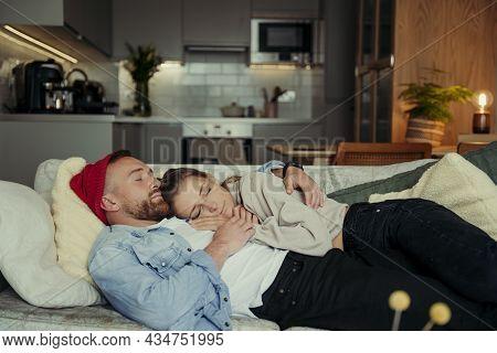 Caucasian Couple Lying On Sofa Cuddling Bonding Together