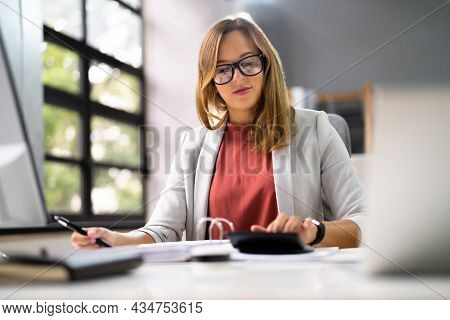 Accountant Women At Desk Using Calculator For Accounting