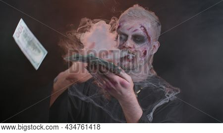 Portrait Of Sinister Man In Carnival Costume Of Halloween Crazy Zombie With Bloody Wounded Scars Fac
