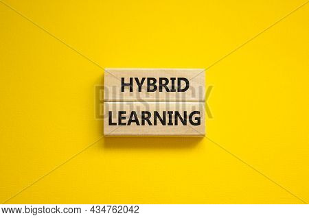Hybrid Learning Symbol. Concept Words 'hybrid Learning' On Wooden Blocks On A Beautiful Yellow Backg