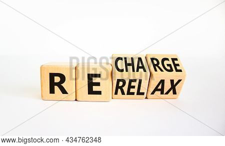 Relax And Recharge Symbol. Businessman Turned Cubes And Changed The Word 'relax' To 'recharge'. Beau