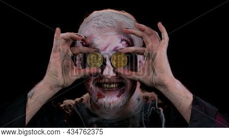 Zombie Man With Make-up With Fake Wounds Scars Showing Golden Bitcoins. Achievement Career Wealth, C