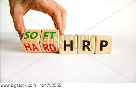 Hrp, Human Resource Planning Symbol. Businessman Turns Wooden Cubes And Changes Words Hard Hrp To So