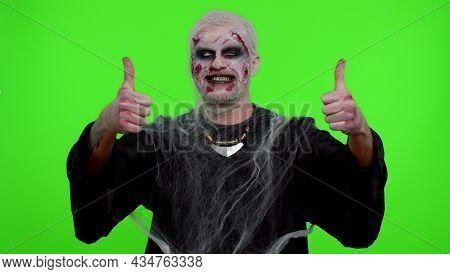 Sinister Man With Scary Halloween Zombie Makeup Raises Thumbs Up Agrees With Something Or Gives Posi