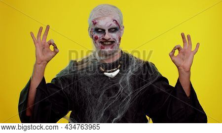 Creepy Man With Bloody Scars Face, Halloween Stylish Zombie Make-up. Scary Wounded Undead Guy Lookin