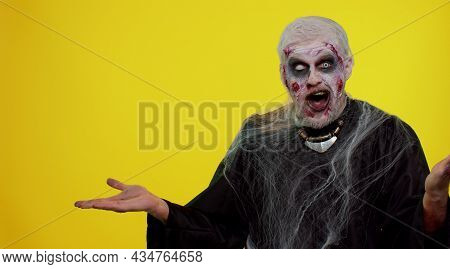 Creepy Man With Bloody Scars Face, Halloween Stylish Zombie Make-up. Scary Wounded Undead Guy Showin