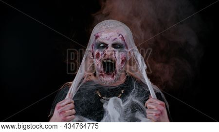 Creepy Man With Bloody Scars Face, Halloween Stylish Zombie Make-up. Scary Wounded Undead Guy Looks