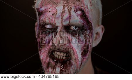 Sinister Undead One Guy. Closeup Macro Frightening Man Face With Halloween Zombie Blood Flows, Drips