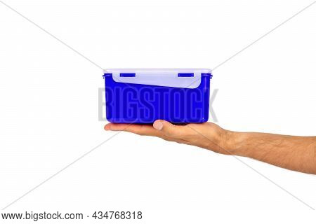 In A Man's Hand Made Of Eco Plastic Of The Current Color, A Lunch Box For A Quick And Pleasant Lunch