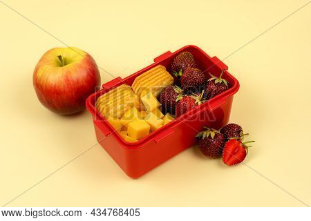 Lunch Box With Fruits, Cookies And Cheese For A Quick Lunch On A Colored Background. Healthy Food.