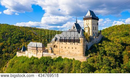 The Karlstejn castle from above. Royal palace founded King Charles IV. Amazing gothic monument in Czech Republic, Europe.